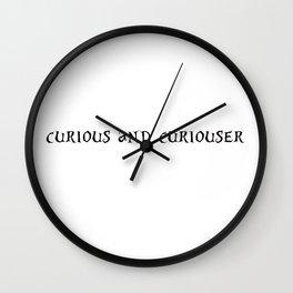 curious and curiouser Wall Clock