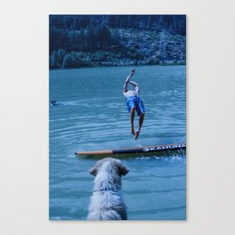 Dog watches master jump in water (Summertime reflections) Canvas Print