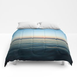 Subtle sunset Comforters