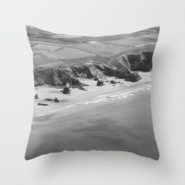 Black and white aerial view of Bedruthan Steps Beach Throw Pillow