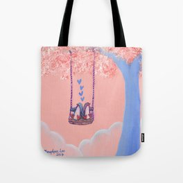 Penguins in Love on Their Tree Swing in a Pink Sky Tote Bag