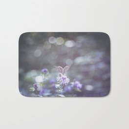 Sun rays and bokeh effect over the butterfly Bath Mat