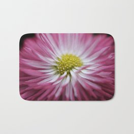 pink bellis on black -1- Bath Mat