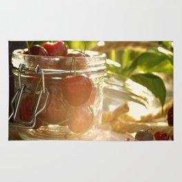 Fresh cherrie in glass Rug