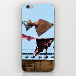 Hanging laundry in blowing wind iPhone Skin