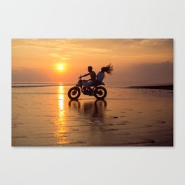 Young couple posing in the beach on custom vintage motorcycle Canvas Print