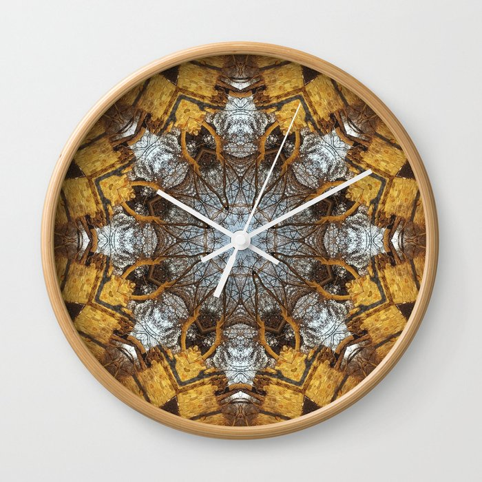 Golden stone, blue sky and arching branches kaleidoscope Wall Clock