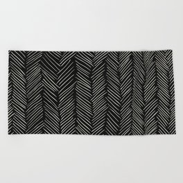 Herringbone Cream on Black Beach Towel