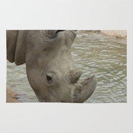 rhino in the jungle Rug