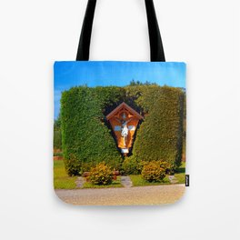 Jesus, a cross and a trimmed bush Tote Bag