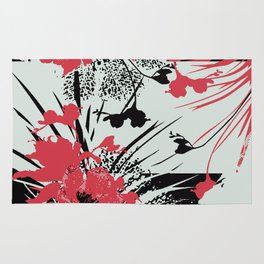 tropical flower silhouettes in red Rug