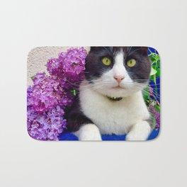 Orazio charming cat in the blue Bath Mat