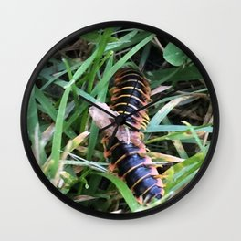He Scuttles Away Wall Clock