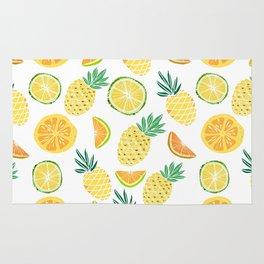 Fresh tropical fruits. Pineapple, orange, lime, grapefruit. Rug