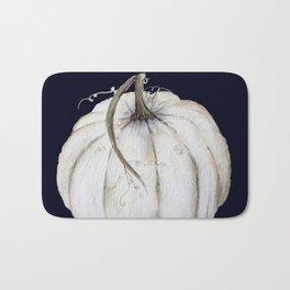 White pumpkin on navy Bath Mat