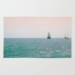Pirate ship at sea Rug