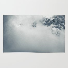 Darkness and mysterious clouds over the mountain Rug