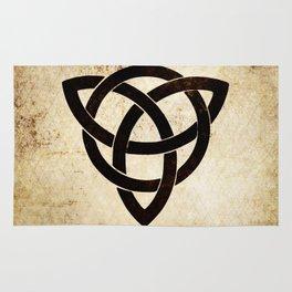 Celtic knot on old paper Rug