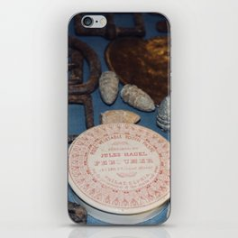 Belt buckles, iron musket bullets and perfume iPhone Skin