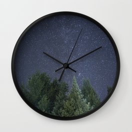 Pine trees with the northern michigan night sky Wall Clock