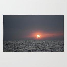 Sunset open sea Rug