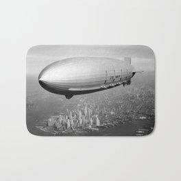 Airship Flying Over New York City Bath Mat