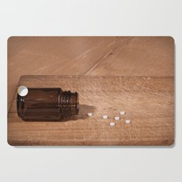 Pills and bottle concept Cutting Board