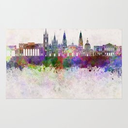 Guadalajara skyline in watercolor background Rug