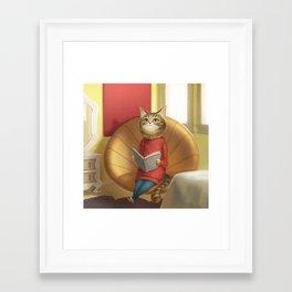 A cat reading a book Framed Art Print