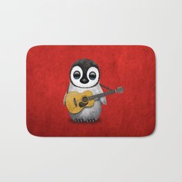 Musical Baby Penguin Playing Acoustic Guitar on Deep Red Bath Mat