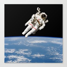 Astronaut Floating Free Canvas Print