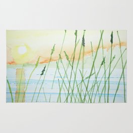 Reeds in a sunset Rug