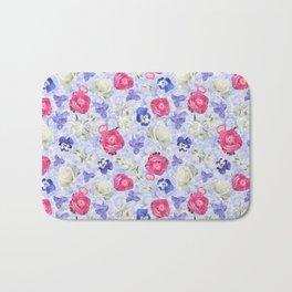 Rose Ranunculus Pansy Flowers over Pale Blue Bath Mat