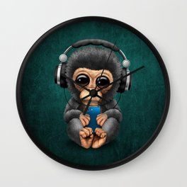 Baby Chimpanzee with Headphones Holding a Cell Phone on Blue Wall Clock