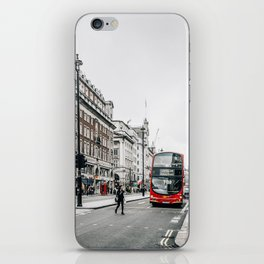 Red bus in Piccadilly street in London iPhone Skin