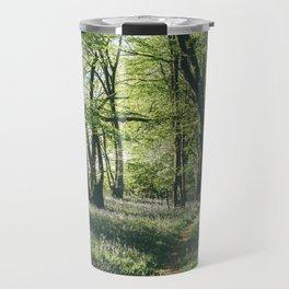 Path through Bluebells growing wild in natural woodland. Wayland Wood, Norfolk, UK. Travel Mug