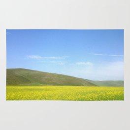 yellow flower field Rug