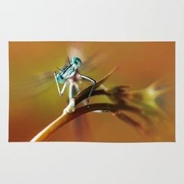 Blue dragonfly on pink flower Rug