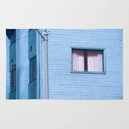 vintage blue wood building with window and electric pole Rug