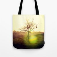arya stark Tote Bags featuring Stark Sunrise by Mark Bagshaw Photography