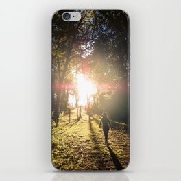 Woman hiking along an Oregon forest trail at sunset iPhone Skin