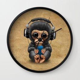 Baby Chimpanzee with Headphones Holding a Cell Phone Wall Clock