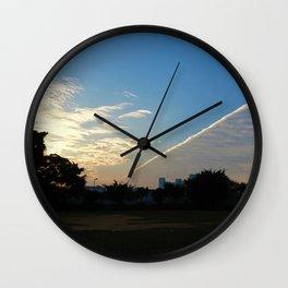 drama in the sky Wall Clock