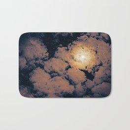 Full moon through purple clouds Bath Mat
