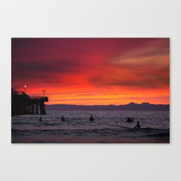 Surfers watching Sunset Canvas Print