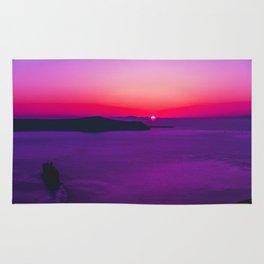 purple sunset in Fira Santorini Rug