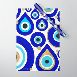 Evil Eye Charms on White Wrapping Paper