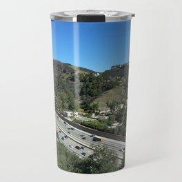 City in mountains, highway passing through Travel Mug