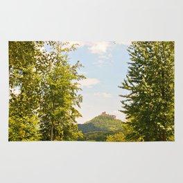 Trifels castle framed by green trees Rug