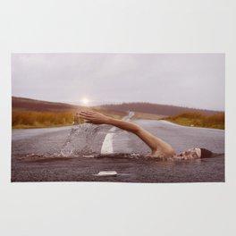 surreal swimmer Rug